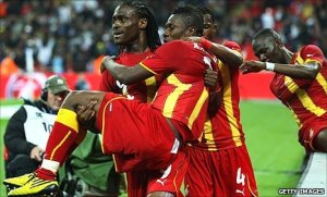 Derek Boateng picks up Asamoah Gyan after Gyan scoring England